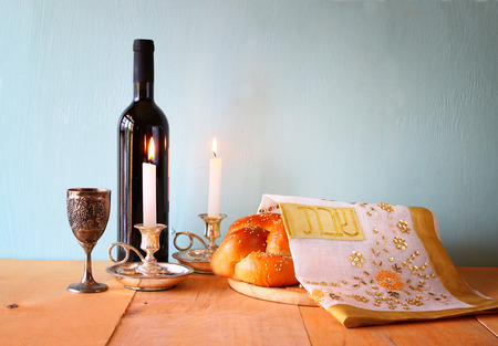 candlestick: Sabbath image. challah bread and candelas on wooden table