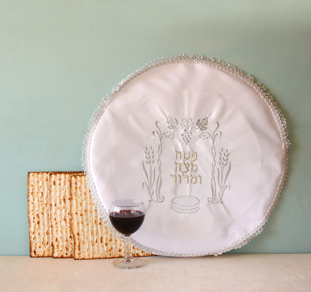 matzot: passover background. wine and matzoh (jewish passover bread) over wooden background.