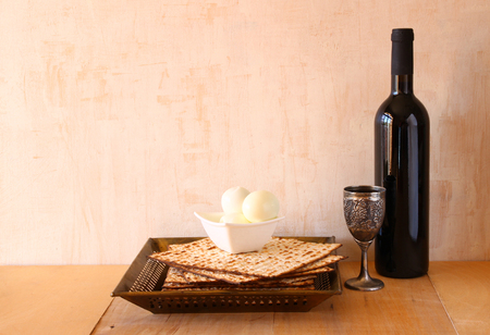 matzo: Passover background. wine and matzoh (jewish passover bread) over wooden background.