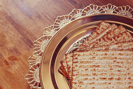 matzos: top view of passover background. matzoh (jewish passover bread) over wooden background.