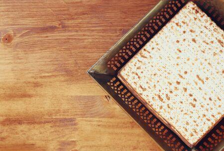 Top view of passover background. matzoh (jewish passover bread) over wooden background. photo