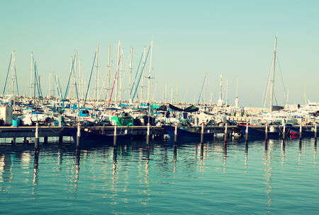 romantic marina with yachts. retro filtered image photo