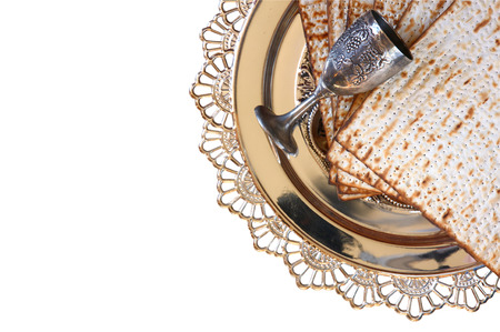 matzos: top view of passover background. matzoh (jewish passover bread) and traditional sedder plate. isolated on white