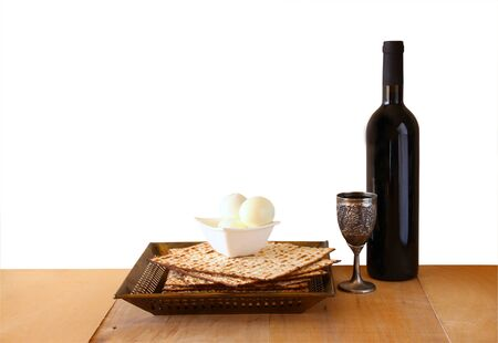 matzoth: top view of passover background. matzoh (jewish passover bread) and traditional sedder plate over wooden background