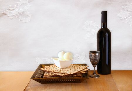 matzos: top view of passover background. matzoh (jewish passover bread) and traditional sedder plate over wooden background