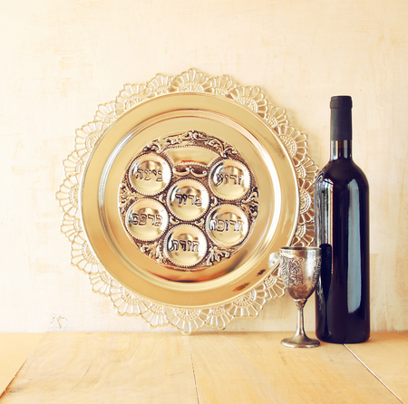 jewish food: Passover background. wine and matzoh (jewish passover bread) over wooden background.