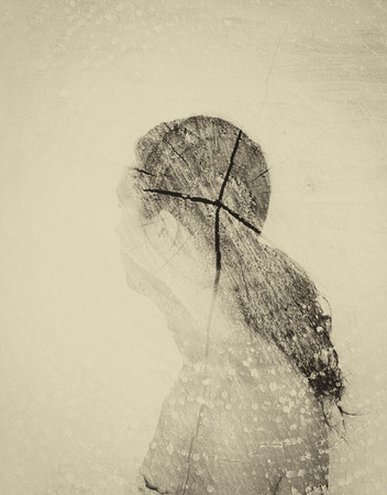 multiple exposure: double exposure photo of young woman and tree log texture. image is sepia toned