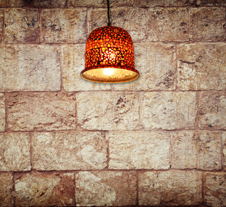 brick wall and ceiling lamps photo