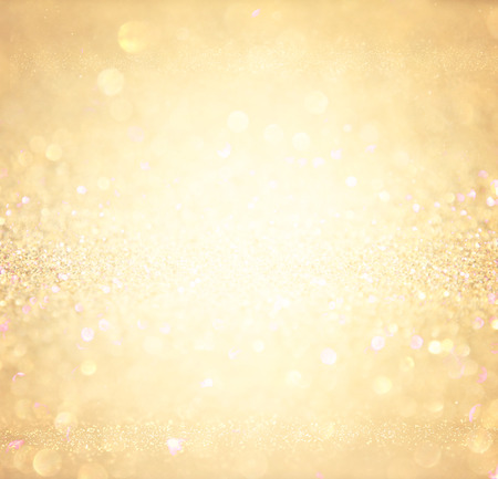 glitter vintage lights background. abstract gold background . defocused 免版税图像