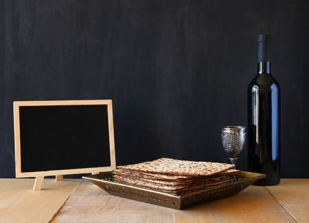 seder: Passover background. wine and matzoh (jewish passover bread) over wooden background.