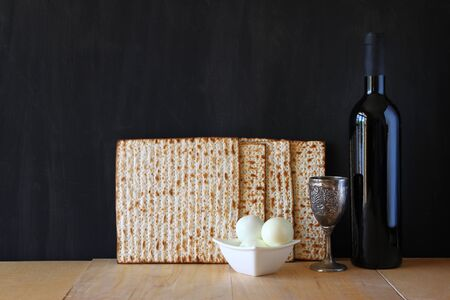 matzos: Passover background. wine and matzoh (jewish passover bread) over wooden background.