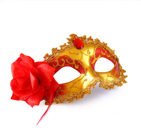 purim mask: gold carnival mask with red flower isolated on white