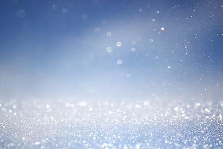 glitter vintage lights background with light burst . silver, blue and white. de-focused. Standard-Bild