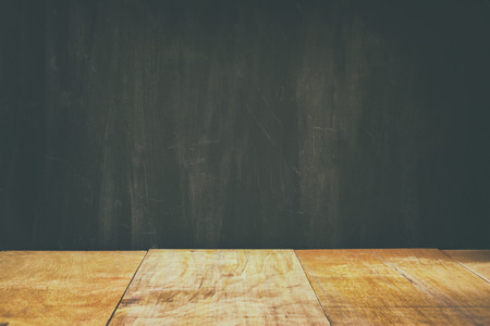 product placement: wooden planks and black board background. ready for mock up or product placement Stock Photo