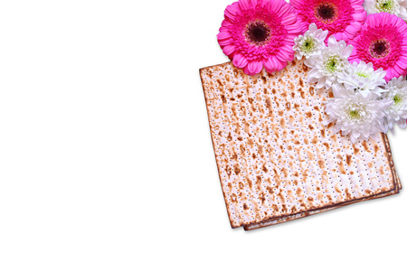 pesakh: passover background. matzoh (jewish passover bread) and flowers isolated on white