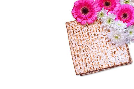 matzoth: passover background. matzoh (jewish passover bread) and flowers isolated on white