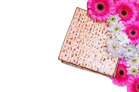 passover background. matzoh (jewish passover bread) and flowers isolated on white photo