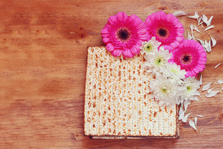 matzoh: passover background. matzoh (jewish passover bread) and flowers on wooden table Stock Photo