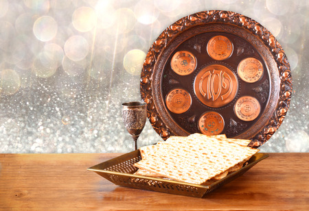 matzoh: passover background. wine and matzoh (jewish passover bread) on wooden table