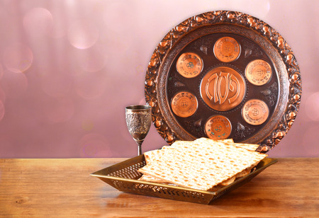 matzoth: passover background. wine and matzoh (jewish passover bread) on wooden table