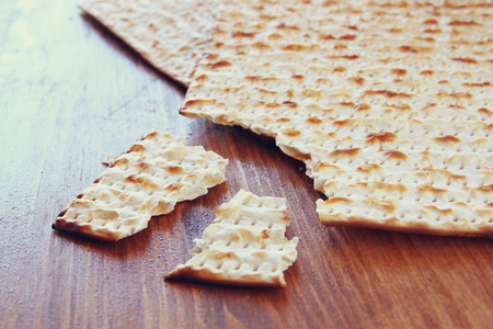 pesakh: Passover background.matzoh (jewish passover bread) over wooden background.