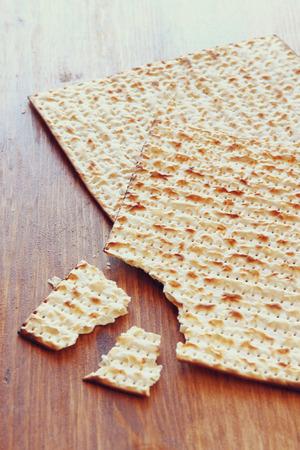 Passover background.matzoh (jewish passover bread) over wooden background.
