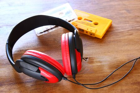 cassettes: top view of vintage headphones and cassettes
