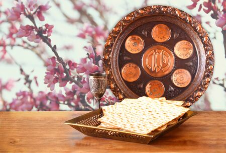 matzot: passover background. wine and matzoh (jewish passover bread) on wooden table