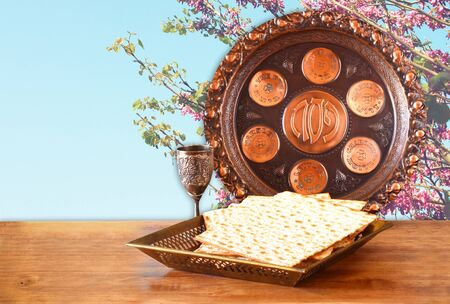 matzos: passover background. wine and matzoh (jewish passover bread) on wooden table
