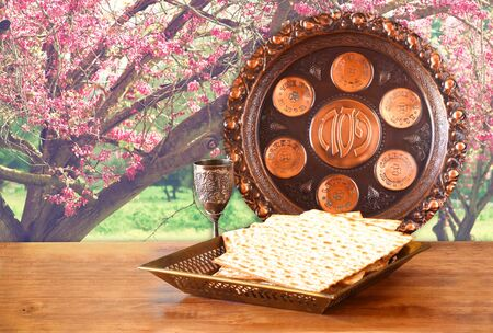 matzo: passover background. wine and matzoh (jewish passover bread) on wooden table
