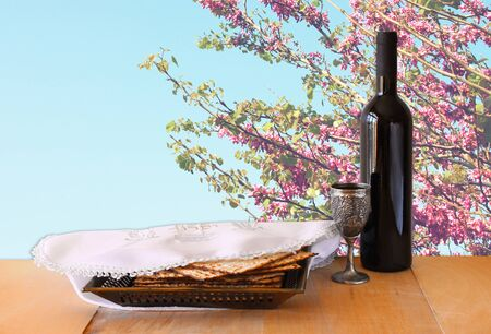 pesakh: passover background. wine and matzoh (jewish passover bread) on wooden table