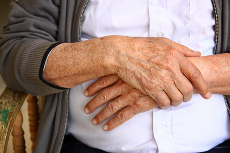 depressed man: close up of elderly male hands Stock Photo