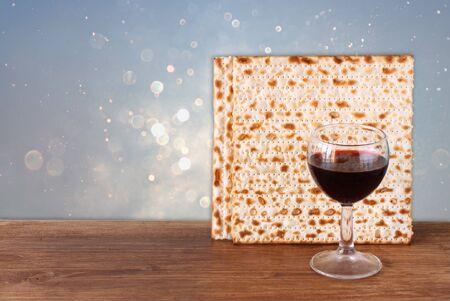 pesakh: passover background. wine and matzoh (jewish passover bread) over blue glitter background.
