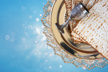 pesah: top view of passover background. matzoh (jewish passover bread) and traditional sedder plate over blue glitter background Stock Photo
