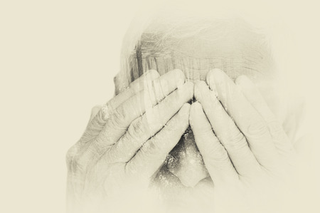 upset: Double exposure portrait of senior man covering his face with his hands. black and white image, vintage effect
