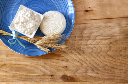 shavuot: top view of greek cheese and cottage on wooden table. Symbols of jewish holiday - Shavuot Stock Photo