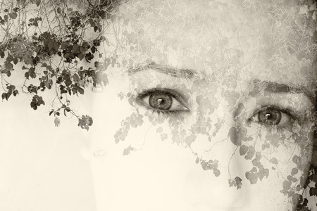 black and white forest: double exposure image of young girl and nature background. black and white style photo