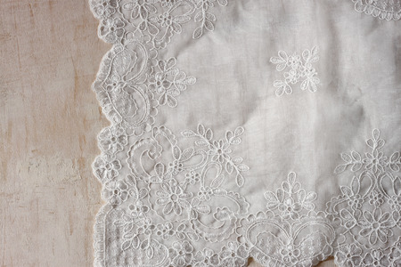 top view of vintage hand made beautiful lace fabric over wooden table
