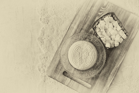 shavuot: image of greek cheese , bulgarian cheese and milk on wooden table over wooden textured background. Symbols of jewish holiday - Shavuot. Black and white style photo