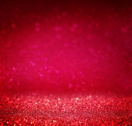 glitter vintage lights background. red and purple. defocused