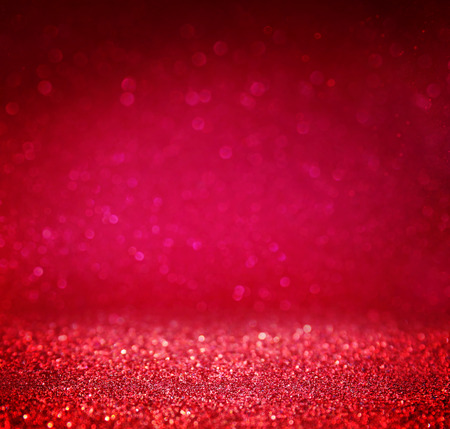 glittery: glitter vintage lights background. red and purple. defocused