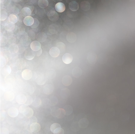 abstract image of glitter vintage lights background with light burst . silver, gold and white. de-focused. photo