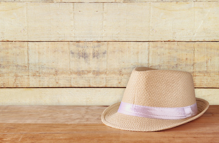 fedora: fedora hat over wooden table and wooden background Stock Photo