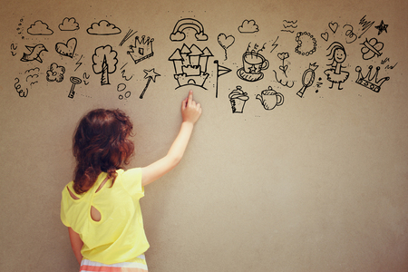 Photo of cute kid imagine space ship fantasy. set of info graphics over textured wall  Stock Photo