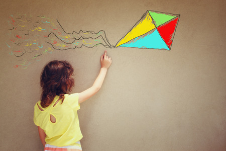 home painting: Photo of cute kid imagine flying kite. set of infographics over textured wall background Stock Photo
