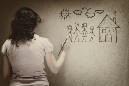 social emotional: black and white image of young woman imaging a family with set of infographics over textured wall background. woman violence and abuse concept