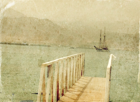 old photograph: Abstract image of one yacht at open sea. Old style photo