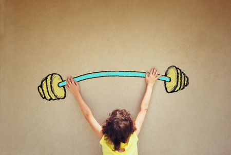 photo of kids back view lifting up barbell weights against textured background