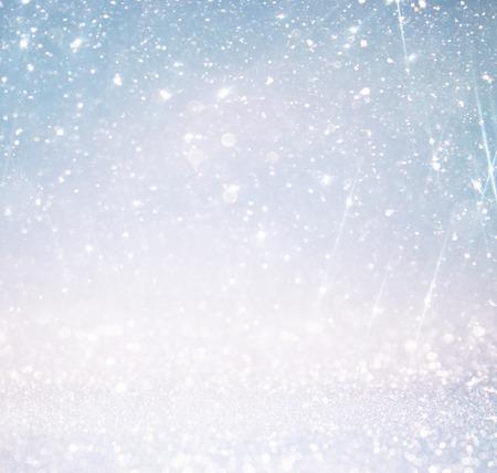 blue background pattern: glitter vintage lights background with light burst . silver blue and white. defocused. Stock Photo