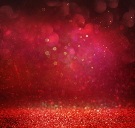 glitter vintage lights background. gold red and purple. defocused Imagens